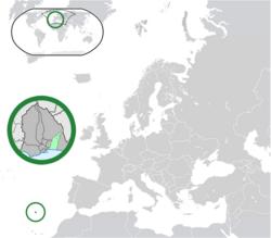 Location of Libertia (center of green circle) in Europe (dark grey)